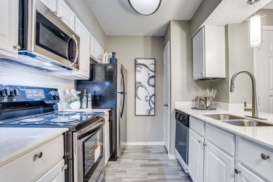 Fully-Equipped Kitchen with Black Appliances and plenty of storage space.