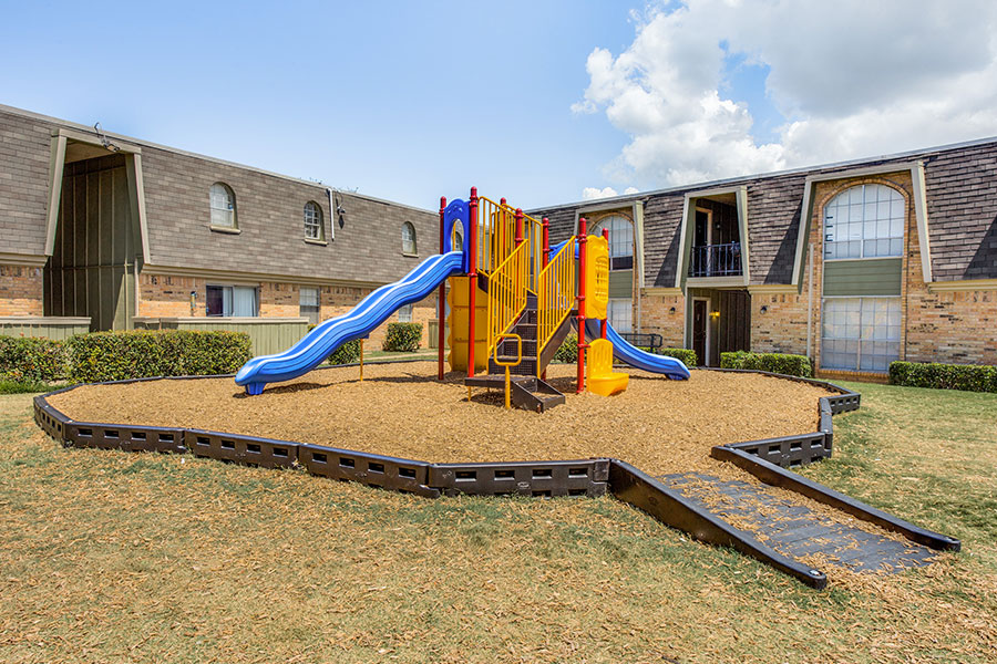 Watch the kids enjoy fun at our community playground