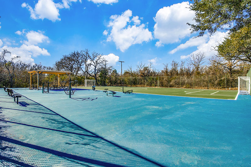 Spacious sports court that includes a fitness and soccer field
