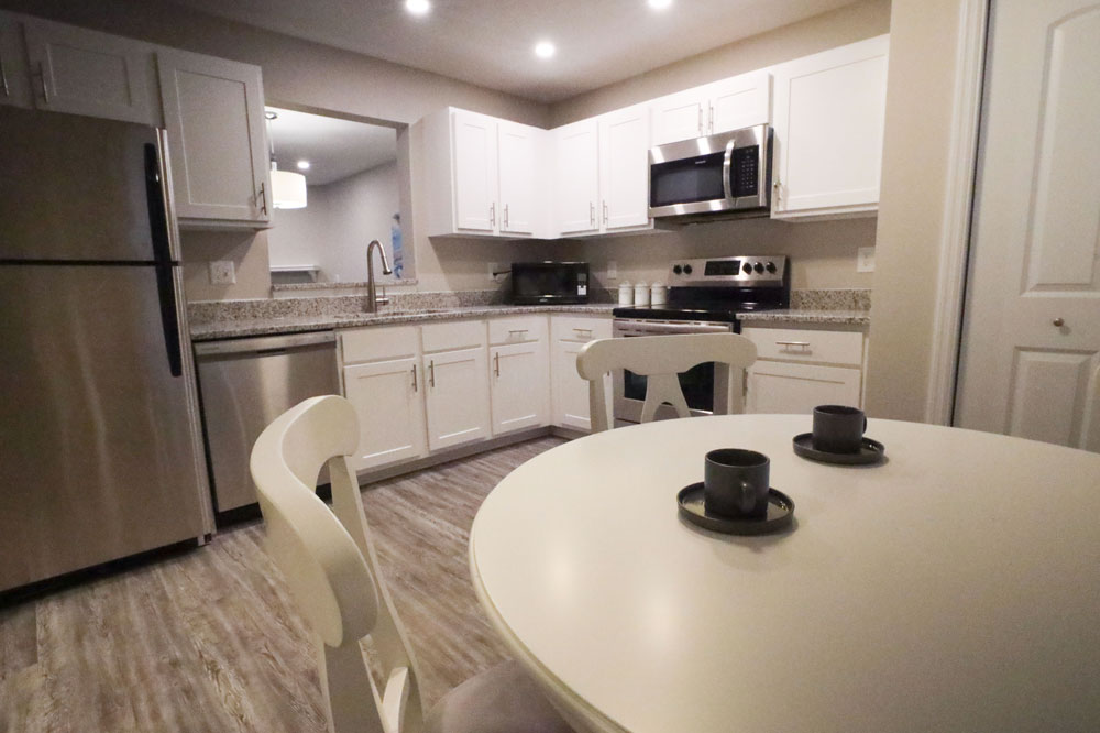 renovated, eat-in kitchens are the highlight of this clever floor plan