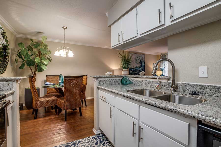 The fully-equipped kitchens and dining room