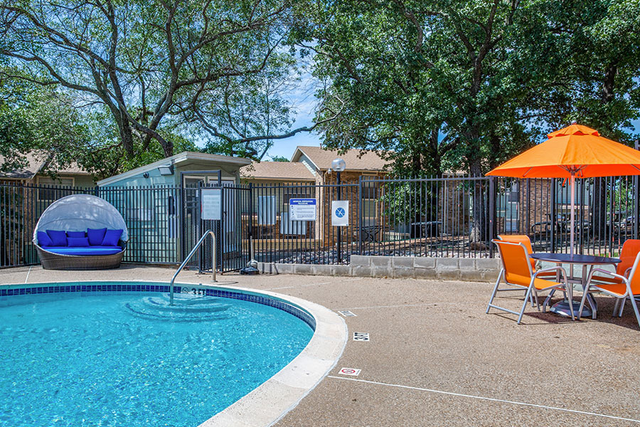 community pool with lounge chairs for additional relaxation