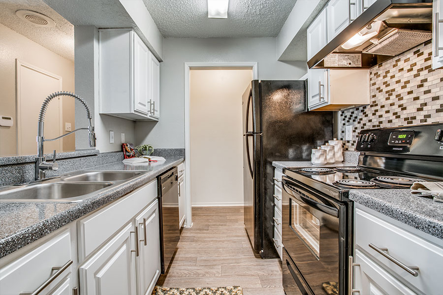 Black Appliance Package and Tile Backsplash Available in Upgraded Apartments