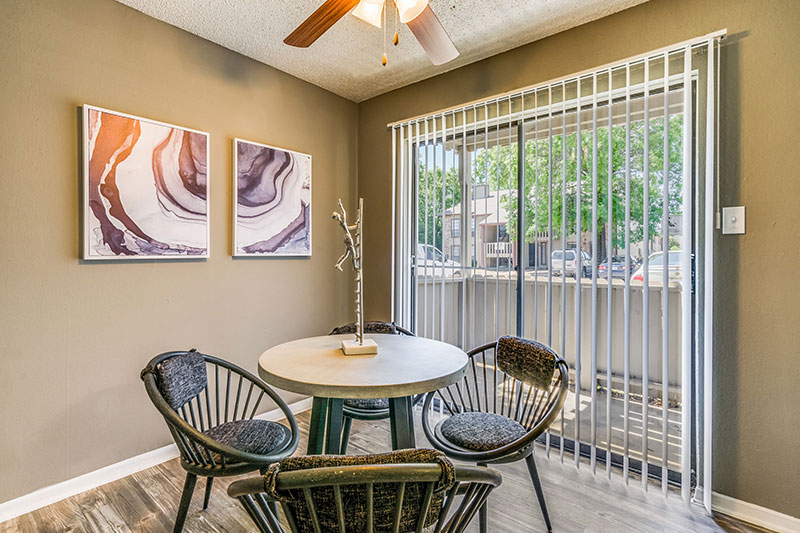 Dining Room with ceiling fan and direct access to private patio.