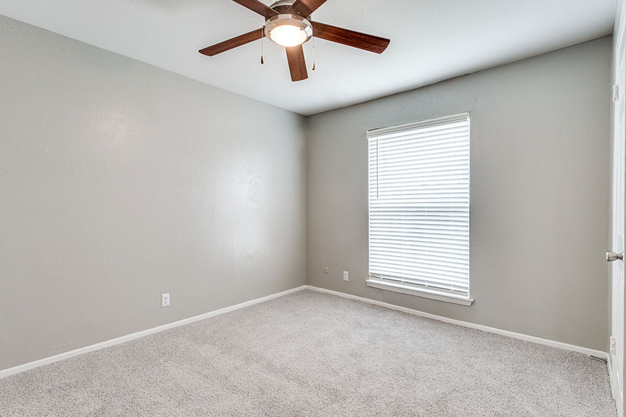 large master bedroom suite with new carpeting