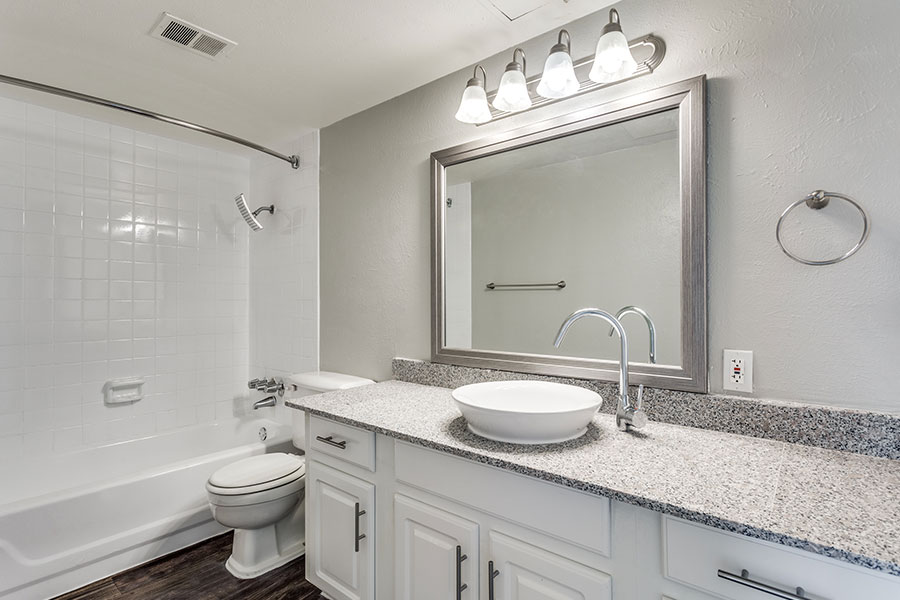 bathroom features a large tub with modern finishing