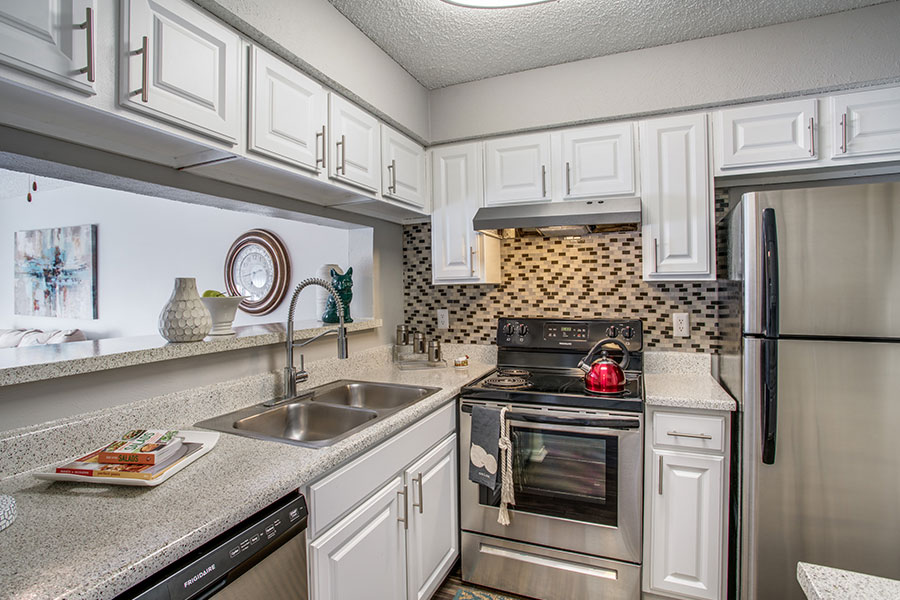 Fully -Equipped Kitchen with Stainless Steel Appliances.