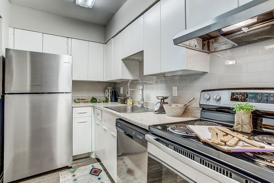 Fully-equipped kitchen with stainless steel appliances.