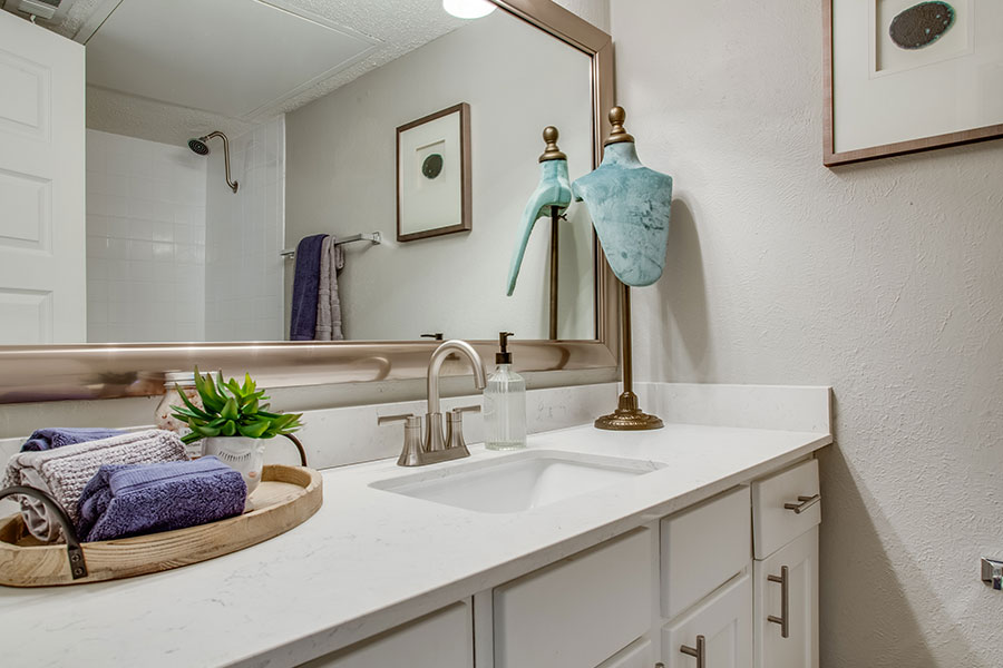 Designer bathroom with plenty of storage.