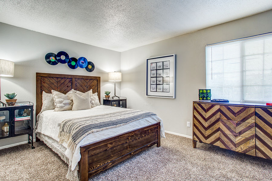 Spacious Bedroom with window treatments, carpet.