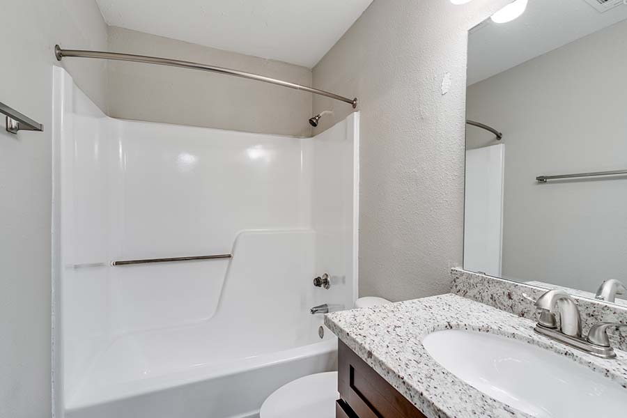 full bathroom with a tub/shower combo