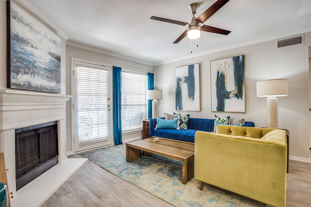 Stunning living area with Luxury Vinyl Plank Flooring (in select units), Fireplace, Ceiling Fan and direct access to Patio or Balcony.