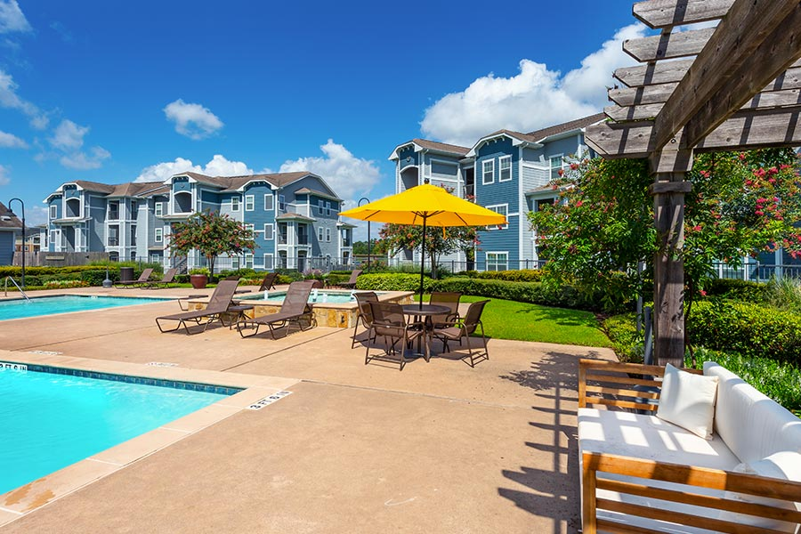 Cool off at our community swimming pool and poolside lounge chairs.