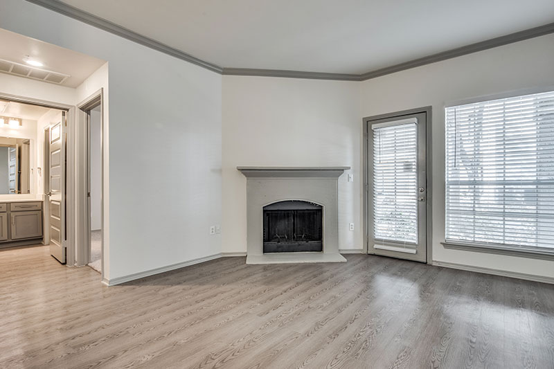 Beautifully appointed living room with wood burning fireplace, crown molding and 9' foot ceilings.