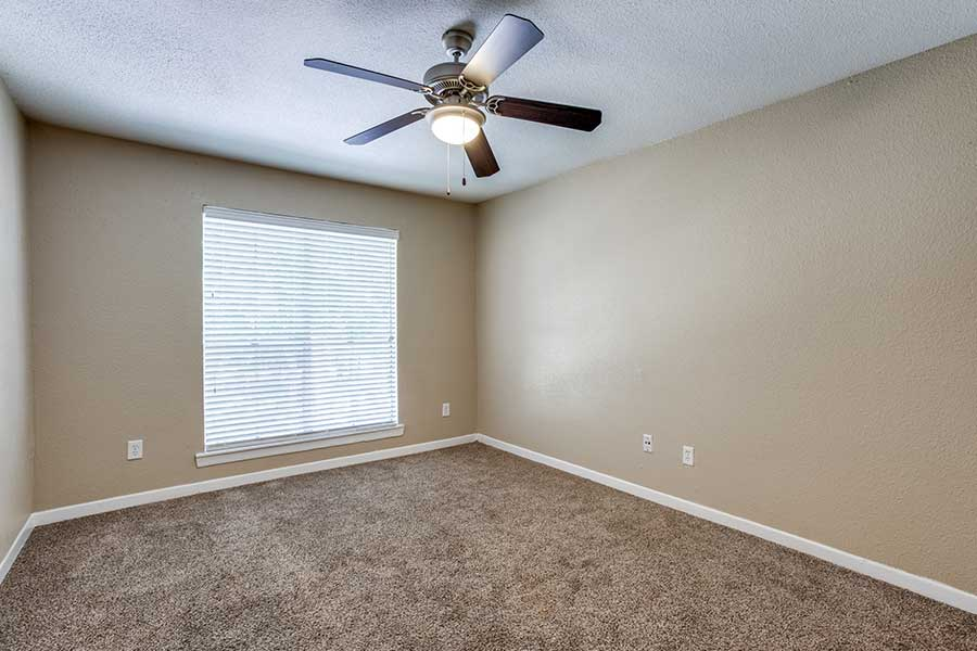 spacious oversized closets, and ceiling fans.