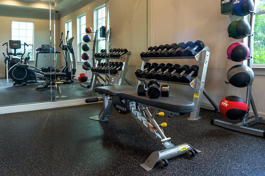 Fitness center filled with strength equipment