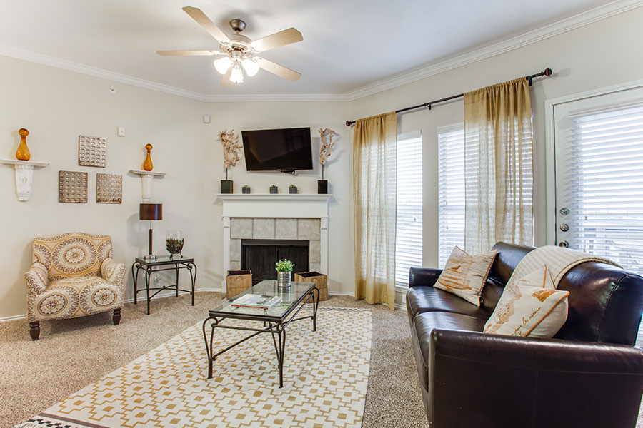 Spacious Living Room - Open Concept Living with Fireplace and access to the balcony or patio.