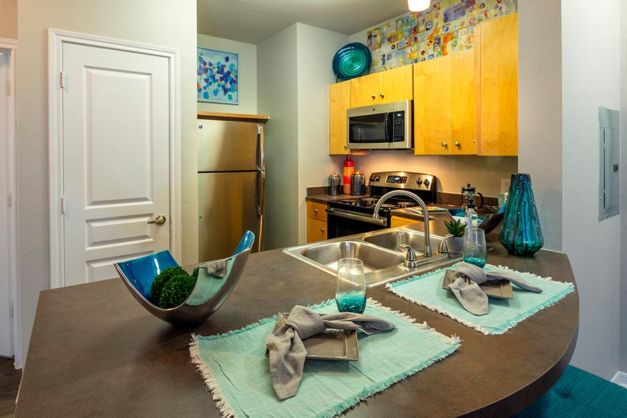 Open-concept layout with fully-equipped kitchens