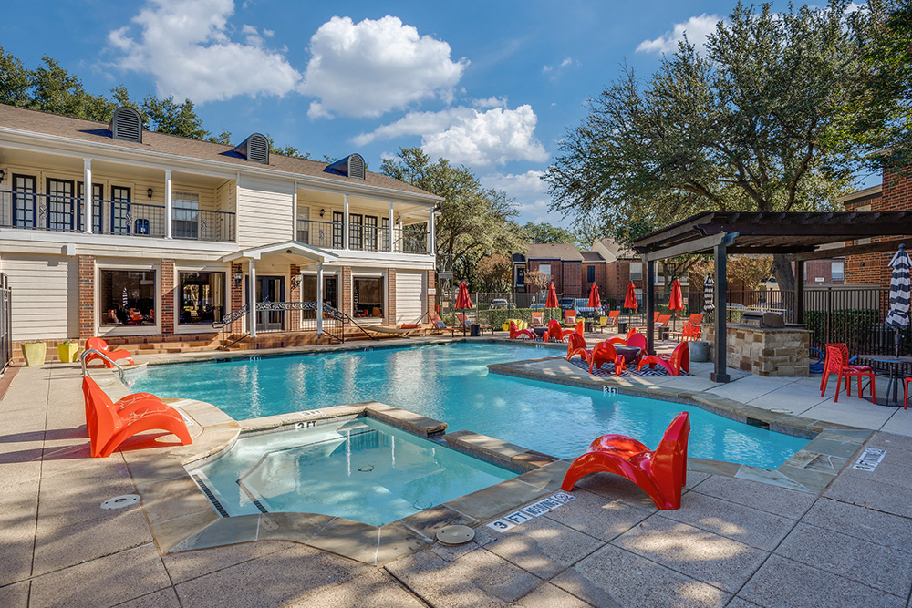 Sparkling swimming pool with expansive sundecks!
